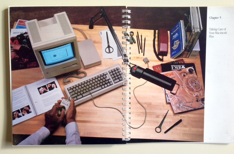 Photo of Chapter 5 opener (a two-page photo of a man removing a mouse ball from a Mac Plus)