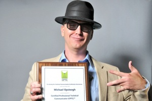 Michael Opsteegh poses with his plaque