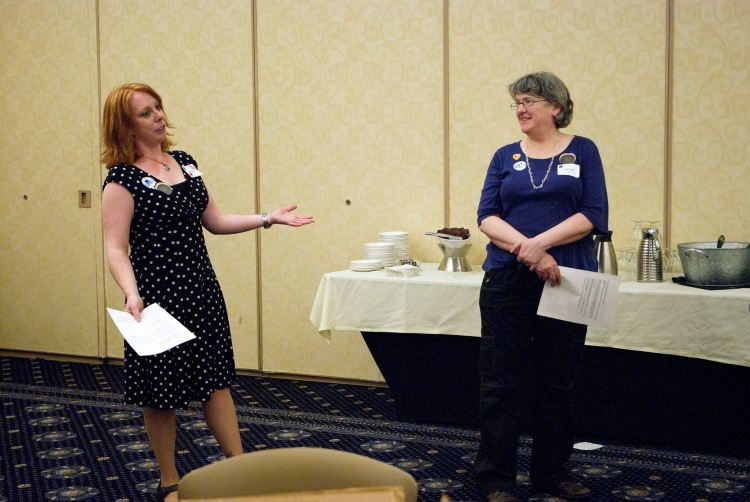 Photograph of Emily Alfson, left, and Nancy Allison, STC New England Council volunteers, at InterChange regional conference, April 2016