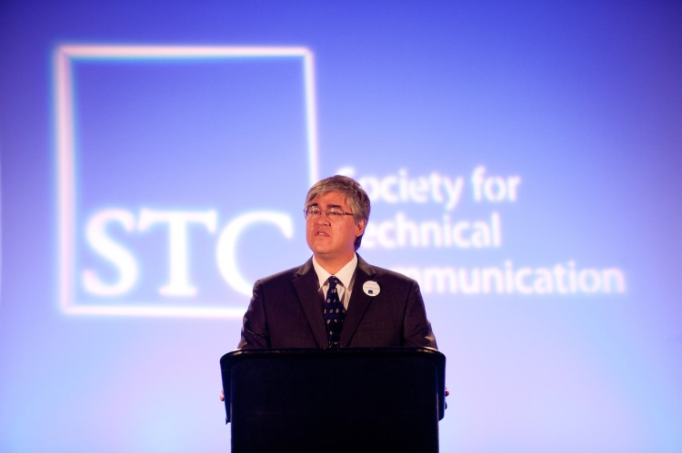 Photo of Steve Jong at the podium of the 2011 STC Summit